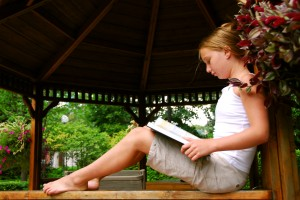 girl reads to prevent summer slide