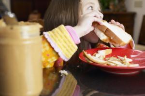 Girl Eating Peanut Butter Sandwich
