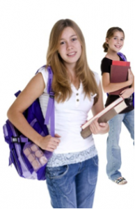 Two girls with book bags