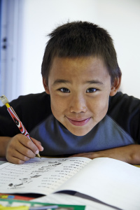 greenlandic boy doing homework